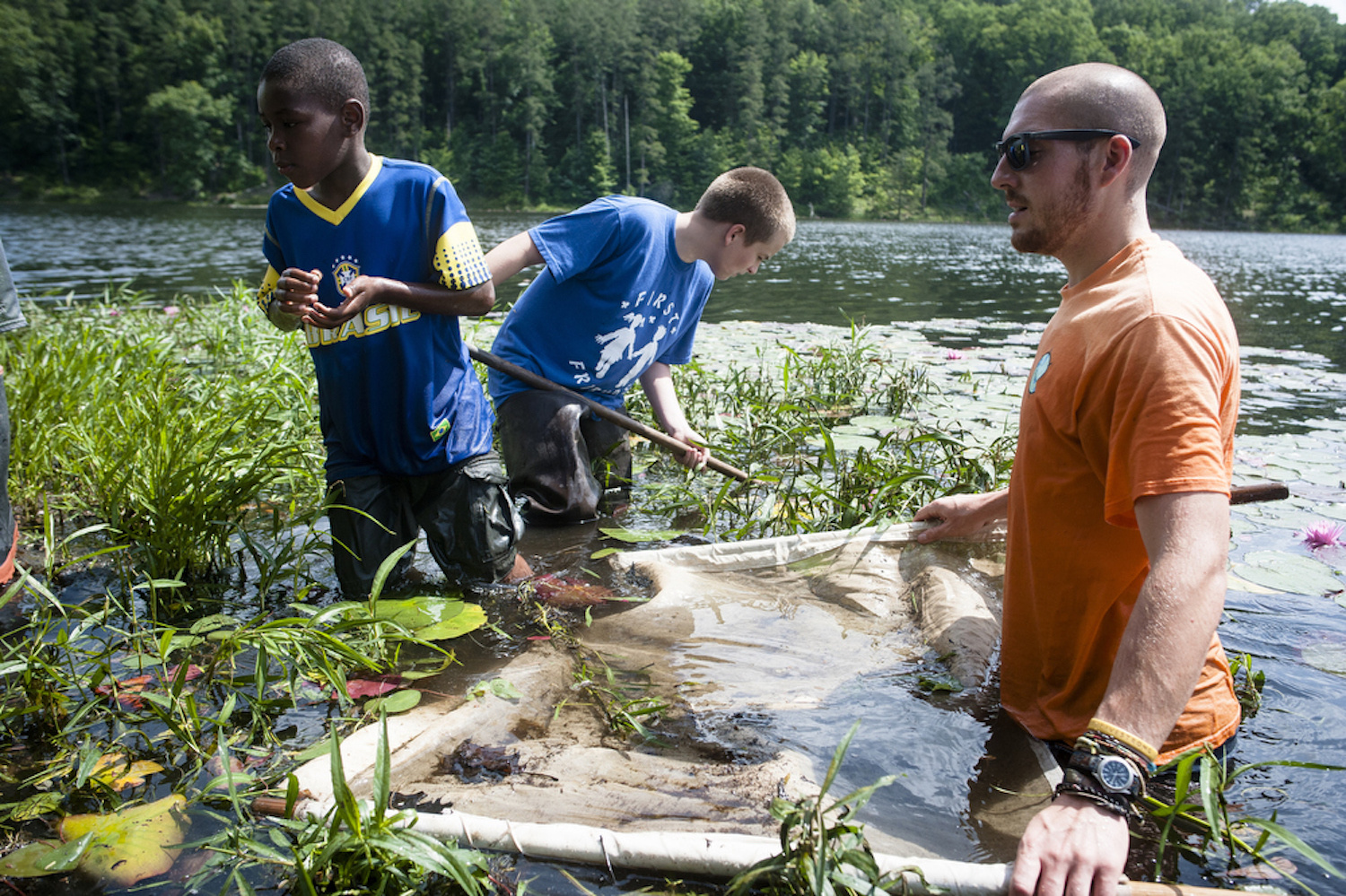 Brien Vincent. 6/18/2014. Rural Action Watershed Restoration AmeriCorps member Rand Romas leads a pond study as part of the KEEN summer camp at Lake Hope State Park near McArthur in Vinton County, Ohio.
